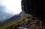Tiny waterfall on a misty mountain